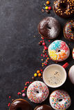 Colorful donuts and coffee cup Stock Image