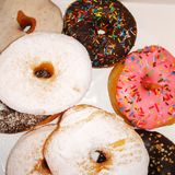 Colorful donuts. With sugared sprinkles stock images