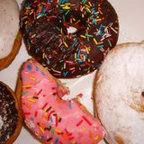Colorful donuts. With sugared sprinkles stock image