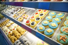 Colorful donuts in different type. From the shelves royalty free stock photography