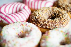 colorful donuts - pastry and sweet food styled concept stock photo