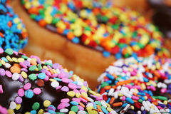 Colorful donuts on plate Stock Photography