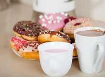 Colorful donuts on   plate Stock Image