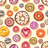 Colorful donuts with sprinkles seamless pattern. Doodle sketch style background. Stock Images