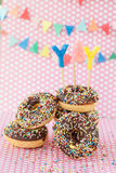 Colorful donuts with sprinkles Stock Photography