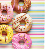 Colorful donuts on a striped napkin Stock Image