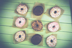 Colorful donuts on table royalty free stock photo
