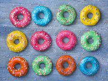 Colorful donuts. On a wooden blue background royalty free stock images