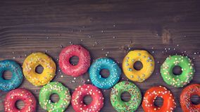 Colorful donuts. On a wooden brown background stock photo