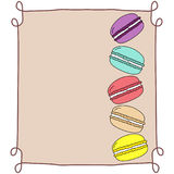 Colorful doodle hand drawn macaroons, stacked, in vintage frame on beige background, copy space, template for bakery, dessert menu Royalty Free Stock Photos