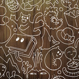 Colorful doodle illustration. Funny crazy doodle illustration set on a wooden texture Stock Image