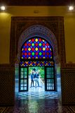 Colorful door at Bahia palace, Marrakech. MARRAKECH, MOROCCO - DECEMBER 11: Colorful door of Bahia palace overlooking the gardens. December 2016 Royalty Free Stock Images