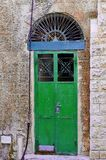 A colorful door in a really old building. Stock Photos