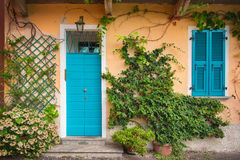 Colorful door and shutters. Lake Como, Italy Royalty Free Stock Photo