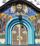 Colorful door to an Orthodox church in Pochayiv Lavra monastery in Ukraine royalty free stock photo