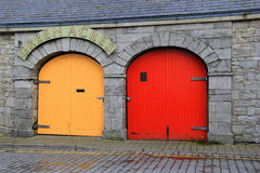 Colorful doors of Green Acres Cheese & Coffee shop,Limerick,Ireland,Octover,2014. Colorful red and yellow doors on the Green Acres Cheese & Coffee shop in Stock Image