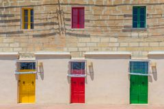 Colorful doors Marsaxlokk. Colorful yellow red and green doors Marsaxlokk harbour, Marsaxlokk, Malta, June 2017 Royalty Free Stock Image