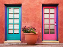 Colorful doors and terracotta wall. Colorful doors and flower pot against terracotta wall Royalty Free Stock Image