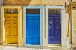 Colorful doors of Valletta, Malta. The West street boasts numerous historical buildings with traditional wooden doors, covered in bright colors, Valletta, Malta Stock Photo
