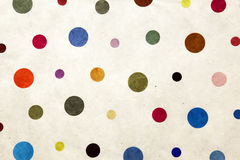 Colorful dots. Textile wallpaper with random sized dots stock images