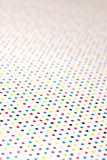 Colorful dots. A bright background of colored dots stock images