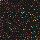 Colorful dots seamless wallpaper pattern. Over black background for your design Royalty Free Stock Images