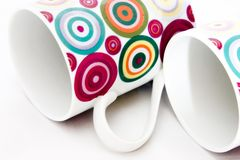Colorful dotted mugs 1. Colorful dotted ceramic breakable mugs stock image