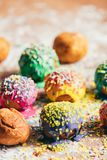 Colorful doughnuts on a kitchen counter. Couple of colorfully decorated doughnuts laying on a dirty kitchen counter. Homemade pastry Royalty Free Stock Photo