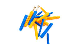 Colorful dowels and screws on white Stock Photography