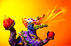 Colorful dragon. Head with tongue of fire flame, traditional Asian decoration and ornamental art, Chinese Zodiac, astrology sign, 2012 New Year symbol Royalty Free Stock Image
