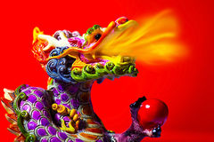 Colorful dragon. Head with tongue of fire flame, traditional Asian decoration and ornamental art, Chinese Zodiac, astrology sign, 2012 New Year symbol Stock Photos