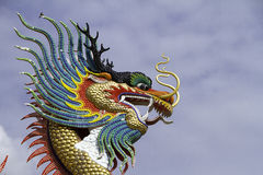 Colorful Dragon. Made from ceramic in sky backgraound.I've taken this photo with tele lens for the dragon's face royalty free stock photos