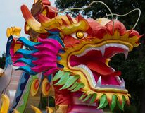 Colorful Dragon open mouth. Colorful dragon with rainbow colors Stock Image