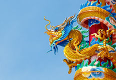 Colorful chinese dragon. Colorful dragon statue  and beautiful dragon with blue sky Royalty Free Stock Image