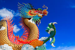 Colorful dragon statue with blue sky Royalty Free Stock Image