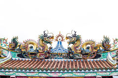 Colorful dragon statue on china temple roof on white. Stock Image