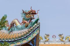Colorful dragon statue on the roof Stock Photo