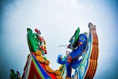 Colorful dragon statue on a Chinese temple roof. stock photography