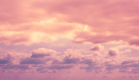 Colorful dramatic lilac sky and ultra violet clouds stock photo