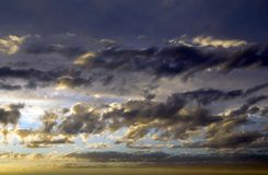 Colorful dramatic sky ans clouds at sunset stock photography