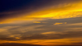 Colorful dramatic sky with cloud at Sunrise.Sky with sun backgro Stock Images
