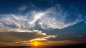 Colorful dramatic sky with cloud at Sunrise.Sky with sun backgro Stock Image