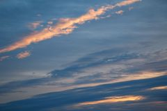 Colorful dramatic sky with clouds at sunset.  Royalty Free Stock Images