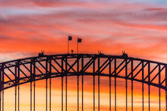 Colorful dramatic sky with silhouette of Sydney Harbour Bridge Stock Photos
