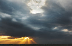 Colorful dramatic sky with sunbeams and heavy clouds at sunset Royalty Free Stock Image