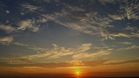 Colorful dramatic sunrise with clouds sky bright horizon burning skies