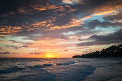 Colorful dramatic sunrise over Atlantic Ocean. Bavaro beach, Hispaniola Island. Dominican Republic Stock Photography