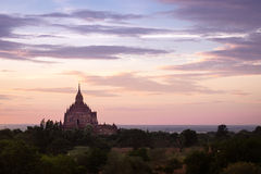 Colorful dramatic sunset of ancient temple in Bagan Stock Photography