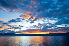 Colorful dramatic sunset over the lake Royalty Free Stock Images