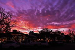 Colorful Dramatic Sunset Over Solvang Danish Town in California. Purple, pink, orange,yellow hues light up the sky on a winter night in Solvang. Christmas lights Stock Photo